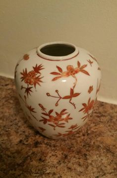 Check out this item in my Etsy shop https://www.etsy.com/listing/259362510/70s-japanese-handpainted-vase