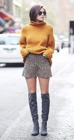 Outfit Idea: Show off your printed a-line miniskirt with knee-high boots, but finish off your subtly sexy pairing with a cozy sweater.