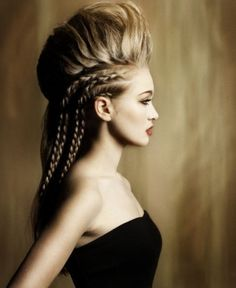 Bold  meets edgy in this voluminous mohawk hairstyle. Tease your hair to create fluffy volume and adding 2 french braids on each side will frame your features giving you a classy allure!
