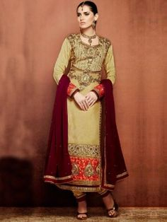 Golden Tusser Silk Suit With Heavy Zari Embroidery And Kundan Stone Work www.saree.com