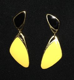 I am not sure of the exact date or designer but you can see in one of the photographs that it is a square with two dots in it. The style appears to be similar to other 1980's earring of this type. They are in very nice condition and have a classy look.