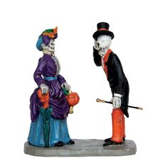 Two skeletons on a lovely spooky evening stroll in their fashionable outfits - Product Type: Figurine - Approx. size (H x W x D): 3.23 x 0.00 x 0.00 inches 8.2 x 0 x 0 cm