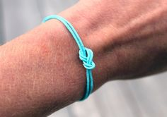 DIY instructions on how to make a love knot bracelet!