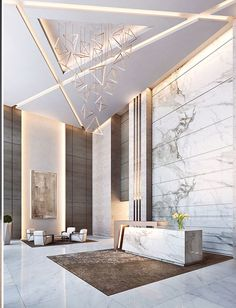 I admire the marble calacatta wall cladding behind the reception desk and the detailed ceiling