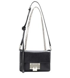 Jimmy Choo - Rebel Soft Mini leather shoulder bag - Ladylike chic at its best, the Rebel Soft Mini shoulder bag from Jimmy Choo is always a smart choice. Multifunctional in a compact format, it can be carried across the body, on the shoulder or by the top handles. Crafted from grainy leather, the classic black hue and knotted shoulder strap add a pretty finish to any look. seen @ www.mytheresa.com