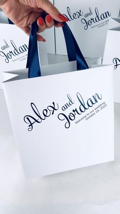 Elegant wedding welcome bags with navy blue satin ribbon handles and custom names. Personalized wedding favors for guests #partyfavors #welcomebags #favorbags #giftbags #favorideas #favors #weddingfavors #weddingparty #weddingwelcomebags #weddingfavour #weddingbag #weddingthankyou #bluewedding #welcomebags #treatbags #navybluewedding #weddinggoodiebags #uniqueweddingfavors