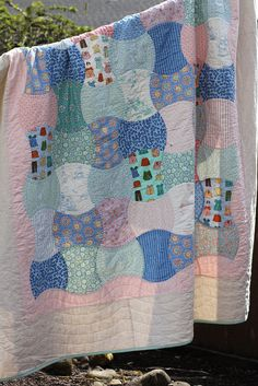 Apple Core Quilt by echoerica, via Flickr...I love how the border is done on this one.
