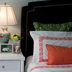 Master Bedroom: dark grey headboard, coral Matouk bedding, green accents