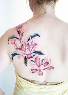 Pink magnolia flower tattoo on the back - a feminine tattoo idea for women - 50+ Magnolia Flower Tattoos
