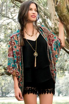 "Kimonos transition into fall with rich colors & sparkly embellishments! The La Mirada Printed Kimono features a beautiful paisley print decorated with gunmetal beading along the trim. Style over a flowy tank & leggins for a cute fall ensemble.<br /> <br /> - 28"" length from shoulder to hem<br /> - measured from a size small<br /> <br /> - 100% Polyester<br /> - Machine Wash<br /> - Imported"