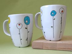 painted mugs - Use paint pens, I tried Sharpie but even following instructions to bake the Sharpie on there it still washes off...