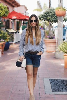 Blogger @oliamajd of Love, Olia wears our dark wash denim shorts.