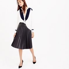 "With accordion pleats and a flattering midi length, our faux-leather skirt looks and feels just like the real thing. <ul><li>Sits above waist.</li><li>23 1/2"" long.</li><li>Falls below knee.</li><li> Poly.</li><li>Back zip.</li><li>Lined.</li><li>Dry clean.</li><li>Import.</li><li>Online only.</li></ul>"