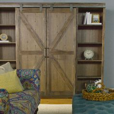 A substantial storage solution with adjustable and removable shelving, our bookshelf is crafted of distressed solid wood with rustic metal accents that give it the look of an old barn door. Configure the sliding doors to organize and display books, photos and collectibles with a personalized touch.