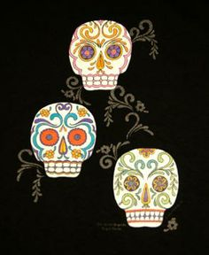 black boutique t=shiort with 3 colorful painted skulls