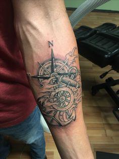 Ship wheel, compass, anchor