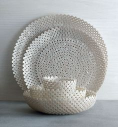 Button Bowls    -   Bowls and trays  made of buttons that are sewn and knotted together.