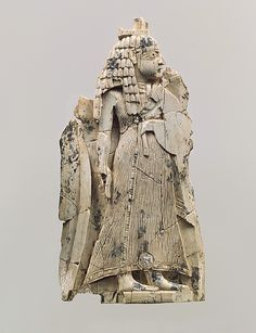 Found in Nimrud, a plaque with a standing figure dressed in Egyptian style.