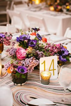 Purple anemone and lilac centerpieces | Photo by Pen/Carlson | Floral design by Fleur
