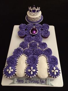 The most beautiful cupcake pull apart cake and smash cake! Sophia the 1st's gown! Made by Cory Knowlton.