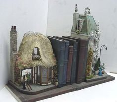 BOOKENDS by Bill Langford, English  thatched roof shop on one and French street scene on another