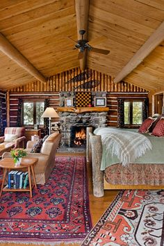 Lake Placid Lodge, NY  -- Cabins are decorated with rich fabrics, antique rugs and stone fireplaces.