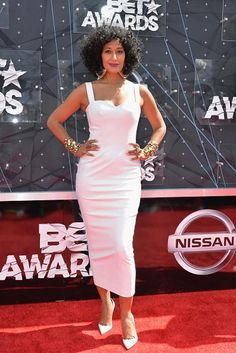 While Tracee Ellis Ross admitted to being nervous prior to her hosting gig, she looked calm and cool — in more ways than one — on the red carpet before taking the stage. Ross' white dress fit her frame perfectly while the simple sheath was taken up a notch with bold gold accessories in the form of multiple bangles and large hoop earrings.
