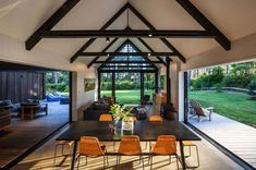 CAAHT Studio Architects created this vacation retreat consisting of two simple gable cabin forms, located in Matarangi, New Zealand. Indoor Outdoor Living, Outdoor Rooms, Exposed Trusses, Cedar Cladding, Living In New Zealand, Traditional Doors, Modern Barn, Cabin Homes, Living Spaces