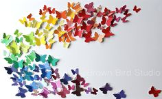 Find out how to make an easy, do-it-yourself art project from free paint samples, paper punches and a large piece of foam core. This colorful butterfly swarm is a kid-friendly activity.  We made it...