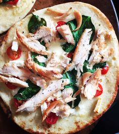 Naan bread pizza.   Toppings:  Margarine/butter Minced garlic  Mozzarella cheese Feta cheese Spinach Tomatoes Chicken breast Pepper  Bake @400 on pizza stone for 15 min
