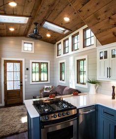 The Denali XL interior includes shiplap walls, stained wood ceilings, and hardwood floors. There is a fir wood entry door and wood clad windows throughout. tiny homes Denali XL by Timbercraft Tiny Homes - Tiny Living Tyni House, Tiny House Cabin, Tiny House Living, Tiny House Plans, Tiny House Design, Tiny House Kitchens, Tumbleweed Tiny House, Tiny Home Floor Plans, Living Room