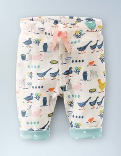 All baby animals love to wriggle and frisk on the season's new green grass so here are some soft, warm, turf-ready pure cotton trousers which are fully reversible with a print you will also find on our cord jacket to make a sweet outfit.