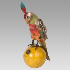 Bocce Ball Parrot - by Mullanium art | BD34- 11 1/2 in H x 12 in L