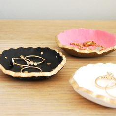 Make these darling painted DIY clay jewelry bowls with air dry clay, a cookie cutter, and acrylic paint. They make a sweet little ring dish for your night table!