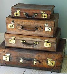 """""""A stack of vintage leather suitcases belonging to someone else"""". I know the feeling!!"""