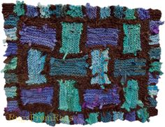 Teal and Blue Lattice:  a rag rug made from #recycled t shirts and other abandoned clothing.  Knit.  www.rugsfromrags.com