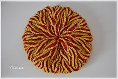 Flaming hat by Lady in Yarn. Fabulous hat pattern. See the Ravelry page for more examples of pattern.,