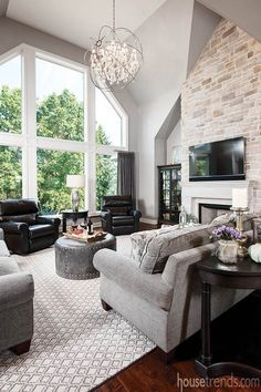 Large windows provide great views in this beautiful living room of a home by Costa Homebuilders in Pittsburgh. #housetrends https://www.housetrends.com/specialist/Costa-Homebuilders