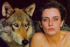 """Wilderness (1996, UK, made for TV). Disturbed young London academic librarian Alice White (Amanda Ooms) has trouble convincing her lover Dan Somers (Owen Teale) that she's a werewolf. They make love in the stacks and she shape-shifts there. Her coworker Serena (Johanna Benyon) thinks that """"academic libraries are the most erotic places on earth."""" Alice moves to a retreat in Scotland, where she changes into a wolf permanently. http://www.imdb.com/title/tt0118169/"""