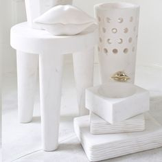 KELLY WEARSTLER | SMALL TRIBUTE STOOL. Hand-sculpted out of a solid block of white marble.