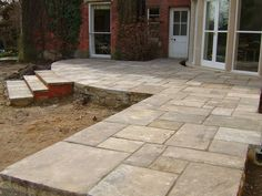 Yorkstone paving is used in gardens on paths, terraces and patios. Telephone 01629 650647 for prices of yorkstone paving, yorkstone steps,coping and bases, plinths and more. Outdoor Paving, Outdoor Steps, Garden Tiles, Garden Paving, Cottage Garden Patio, Stone Garden Paths, York Stone, Stone Driveway, Pergola