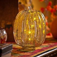 This pre-lit tall silver pumpkin is glamorous harvest décor at its best, made with striking mercury glass for an eye-catching visual treat! Safe for indoor AND outdoor covered use! #kirklands #harvest