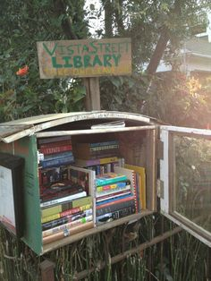 create a little box and fill it with books you have read and don't want anymore? Then set it out in front of your house and let people take the books for free!