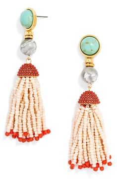 Swirling shell beads, amber-hued stones and playful tassels make up these gorgeous earrings from BaubleBar.