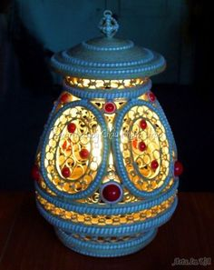 The name of artist is written below - quilled lamp (searched by Châu Khang)