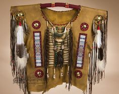 This is an authentic decorative Native American army scout shirt, handcrafted by the famous Creek Indians. This leather scout shirt represents a rich Indian culture with great detail. Made with real d