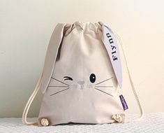 This little bunny bag is very cute and comes with a surprise under one of his ears - his new best friends name! The bag is X and is made using a lovely heavy weight cotton with a twisted cotton rope cord. French seams give extra strength and dura Mochila Tutorial, Bunny Bags, Bunny Bunny, Easter Bunny, Diy Backpack, French Seam, Kids Bags, Backpacker, Treat Bags