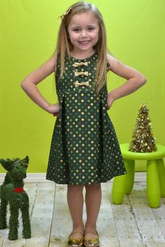 Create Kids Couture - Samantha's Knotted Party Dress PDF Pattern. Samantha features a brand NEW bodice with a cute knot detail that is going to be awesome for mash-ups too! The bodice detail on this sweet dress makes it truly pop! The bodice buttons in the back and has a cute little sleeve detail that is so easy yet so cute. The box pleats on the skirt ensure that the dress is twirl worthy while maintaining classic lines.
