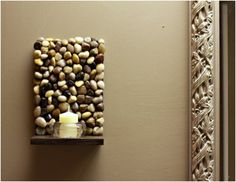 Cut a wood pallet to form the frame and hot glue multiple color rocks