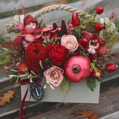 With exotic banksia and ripe garnet♥#bouquet #flowers #flora #floristic #botany #flowerbox #woodbox #stylish #red #fruit #garnet #orchide #rose #banksia #capsicum #pepper #capuccino #mimosa #autumn #autumnflowers #autumnmood #autumncolors #bloom #flowerdesign #flowersminsk #lathyruslavka